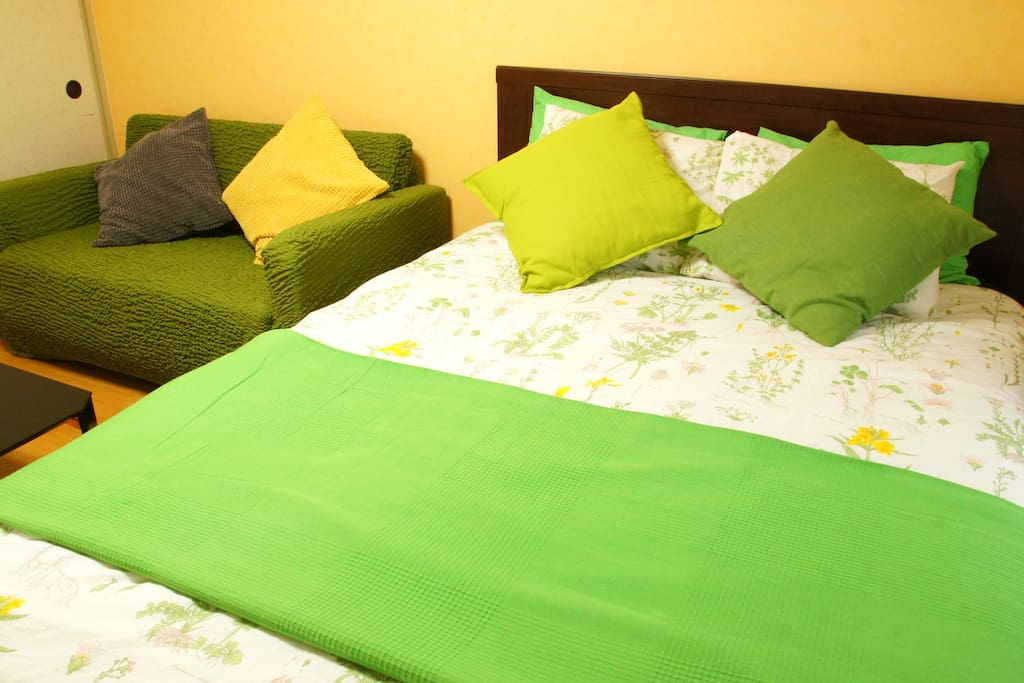 A comfortable double bed and a relaxing sofa!