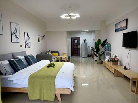 文山乐家民宿(精致北欧大床公寓巨幕投影)毗邻新州医院可洗衣做饭