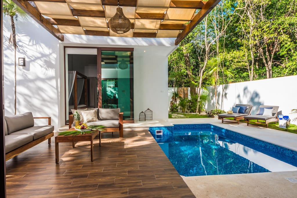 Cool off in the sparkling water of the pool after a day at the beach