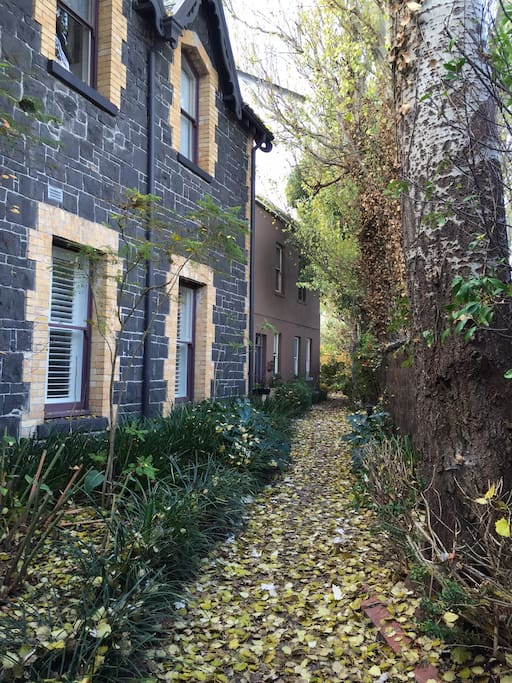 The cottage is at the end of this tree lined footpath, past the bluestone building built as a school in the 1860's.