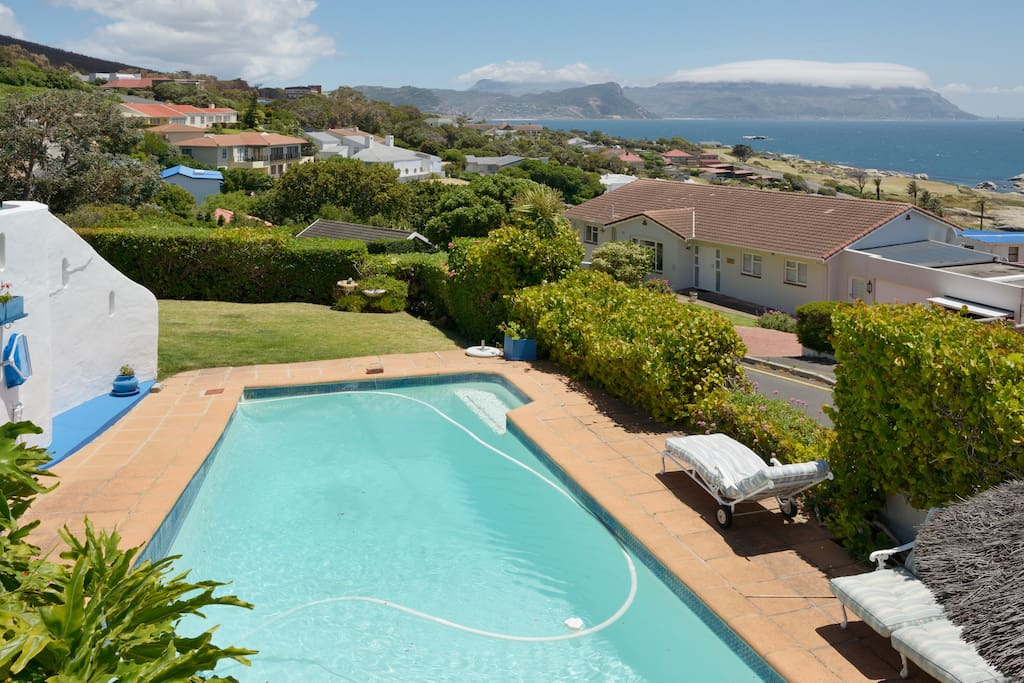 Large swimming pool with garden & braai area.