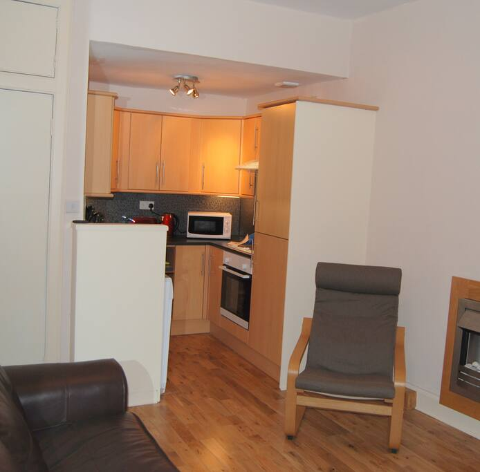 Fully equipped kitchen, with washing machine, electric hob and oven,  microwave oven.