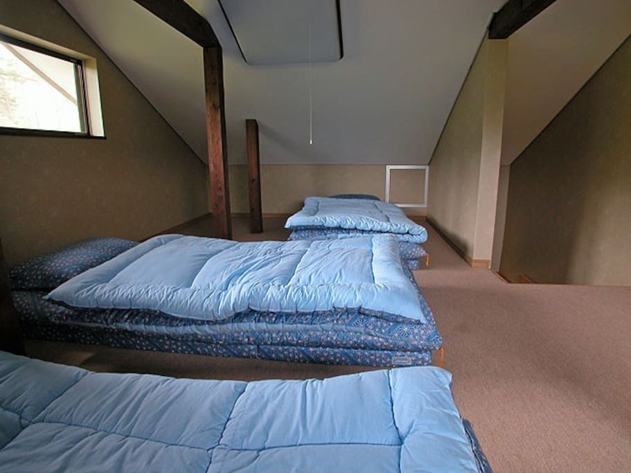 Attic bedroom with three futon beds