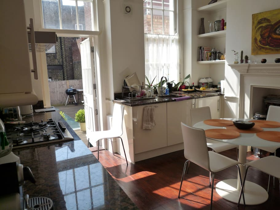Kitchen with exit to roof terrace