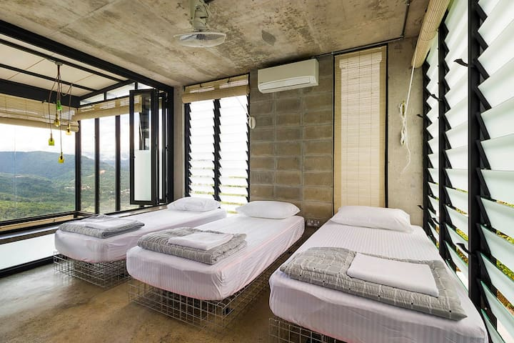 bedroom with  breathtaking view of the emerald green hill