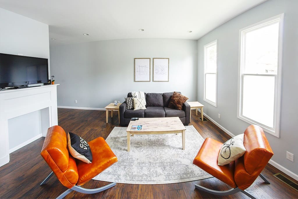 The bright simplicity of the living room with plenty of space to lounge and watch tv!