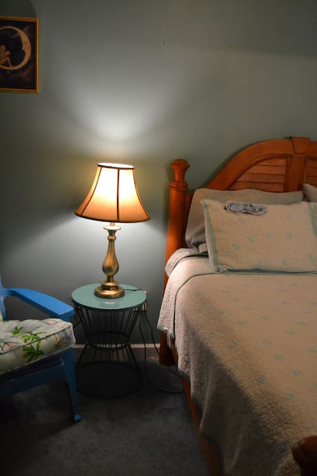 New bedspread, end tables, lamps on either side for comfy nighttime reading.  Also new Adirondeck chair with Pier 1 'By the Sea, by the sea' pillows to get vacay feeling like it's started!
