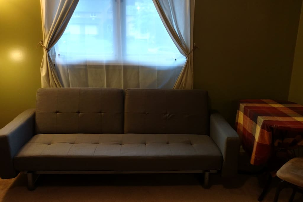 Room has a sleeper sofa that allows an additional bed