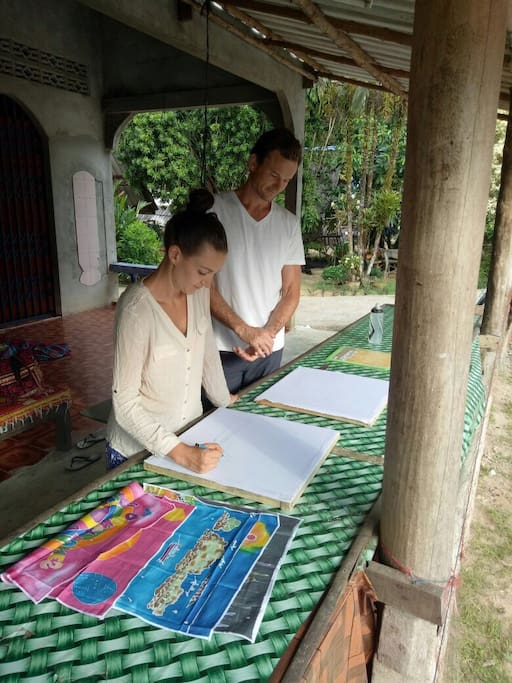 Guests painting Batik