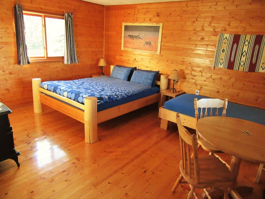 Moose Cabin Room with log bed, wooden floors