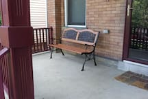 Large porch great for relaxing and listening to the trees and birds on the boulevard