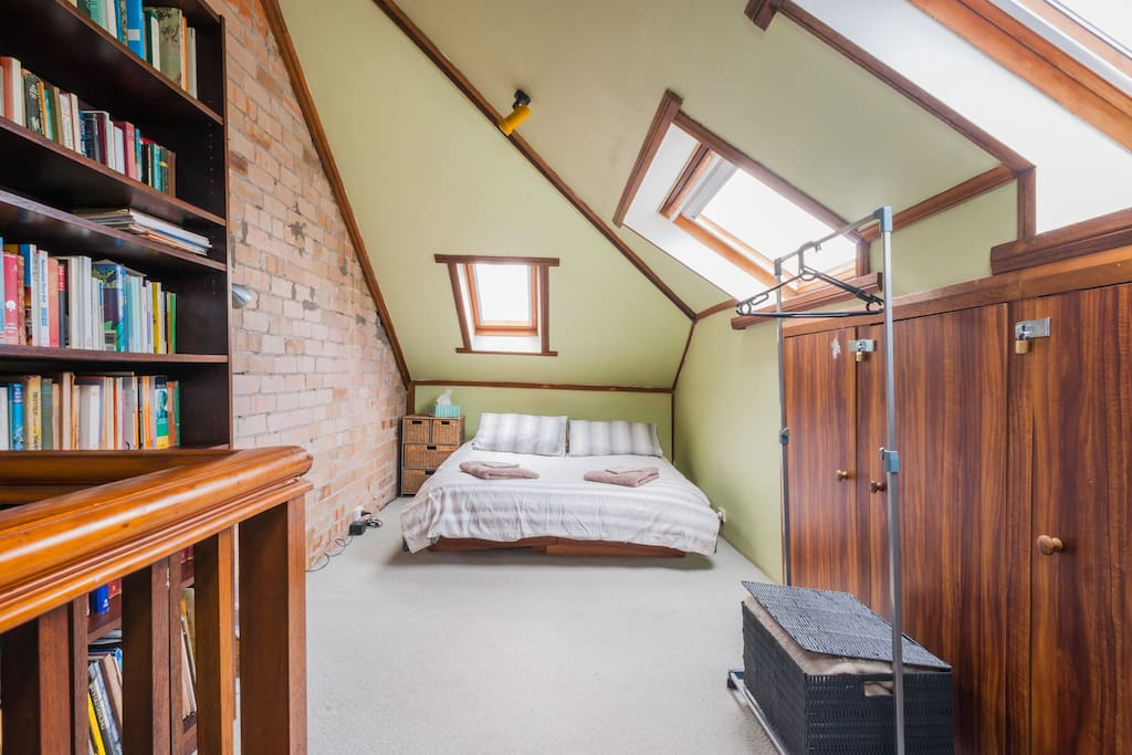 The Attic bedroom 3; A double bed and convertible single bed, with sweeping views of Bondi and the Pacific Ocean through it's northern and easterly attic windows.