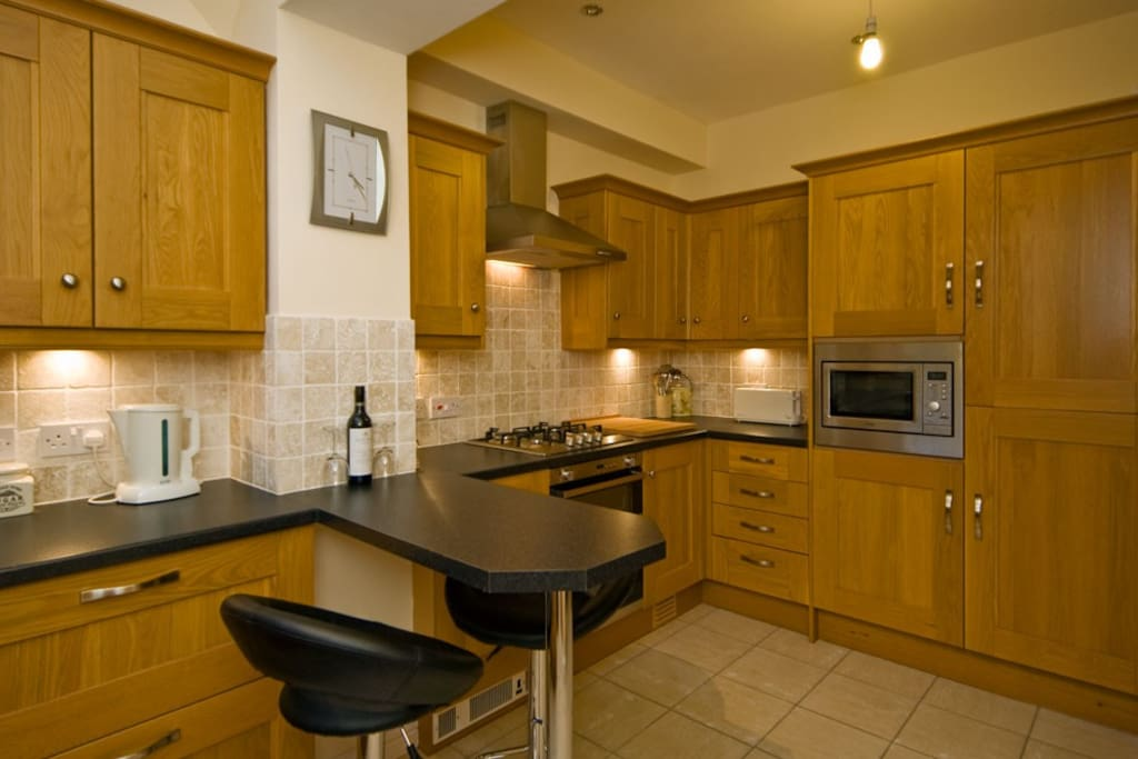 Fully fitted kitchen with Fridge Freezer / Microwave / built in gas stove / two ovens / dishwasher