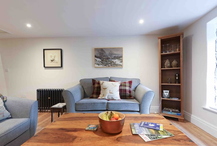 Comfortable living area for relaxing with a good book or enjoying some downtime watching  TV.