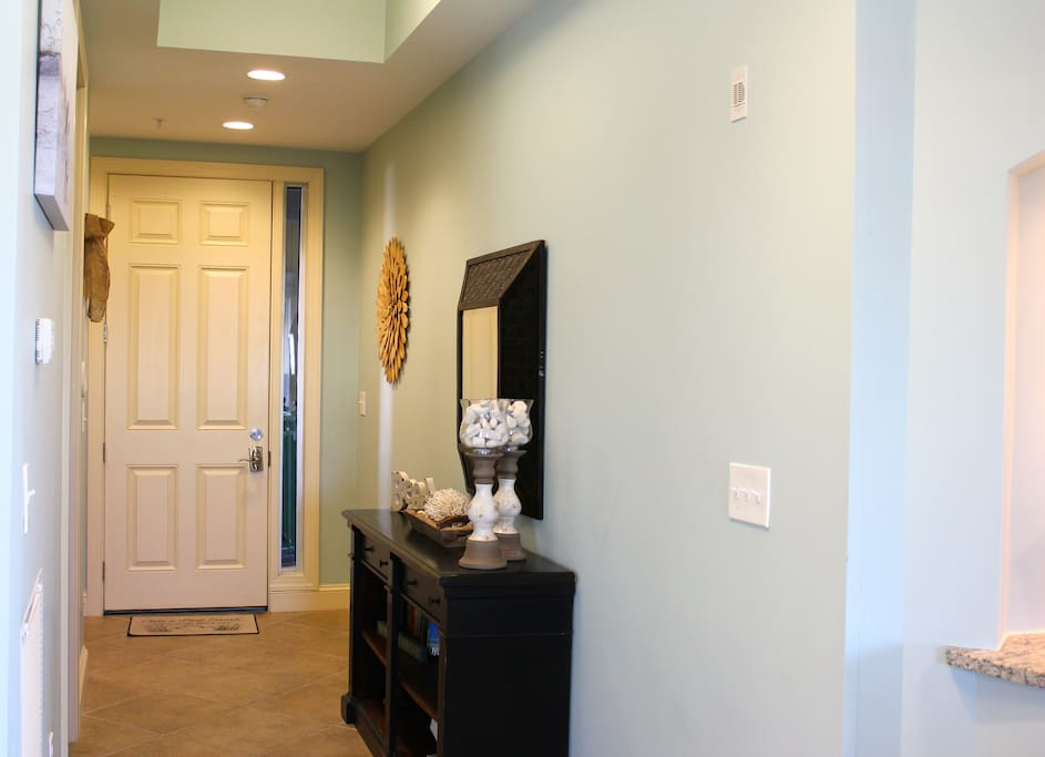 Large entry with 10 foot ceilings throughout gives the condo an open feel.