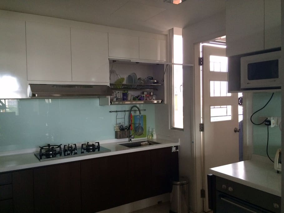 Kitchen, renovated in 2013. Stove, microwave, toaster, and conventional oven. Please note: There is NO dishwasher. Dishwashers are rare in Singapore.