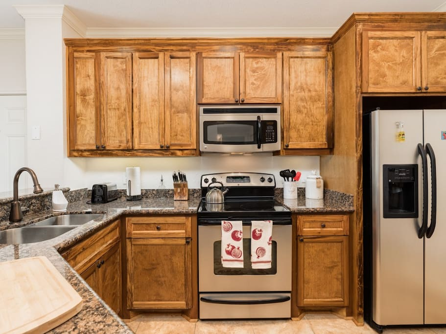 The kitchen features a full suite of stainless steel appliances.