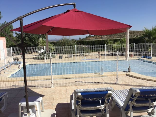 Your view from the lounge and also the bedroom.  Our very safe swimming pool with a lockable gate so young children and none swimmers cannot enter unaccompanied.