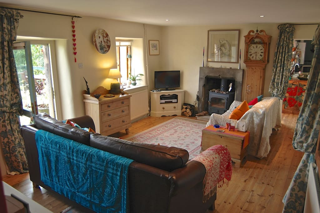 The cosy characterful sitting room with its clearview log burner.