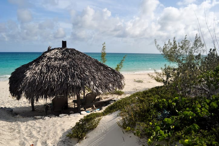 Our private beach and tiki hut. Gorgeous 235 feet of white sand beach.