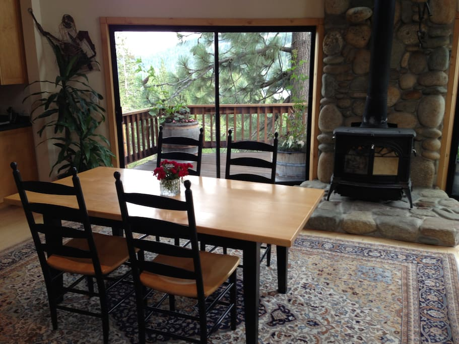 Dining room table and chairs, wood flooring and carpet