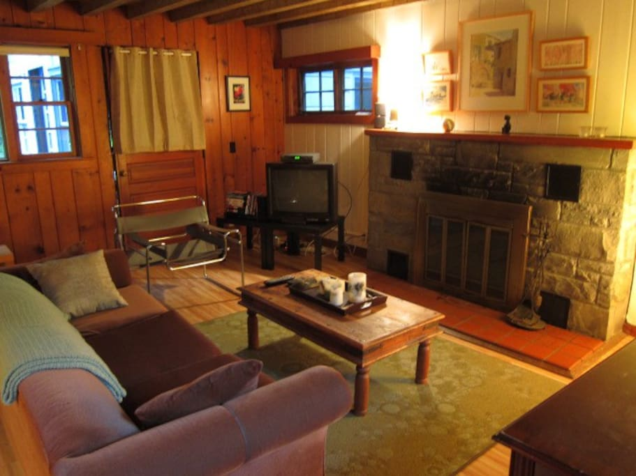 Our cozy den where you can relax near the fireplace, watch TV or get online.