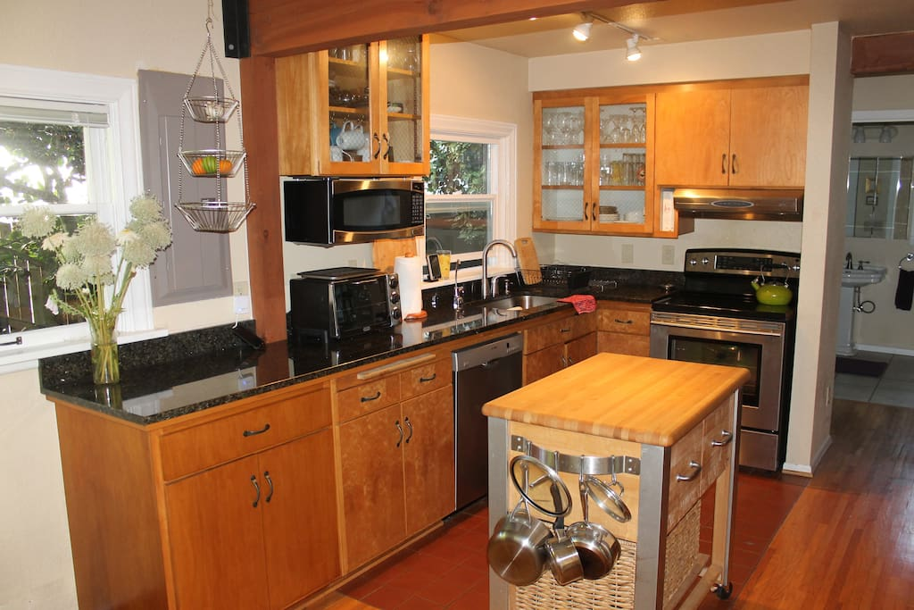 Big kitchen with granite countertops and nice appliances