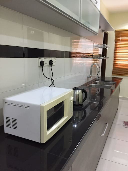 Kitchen with kettle and microwave