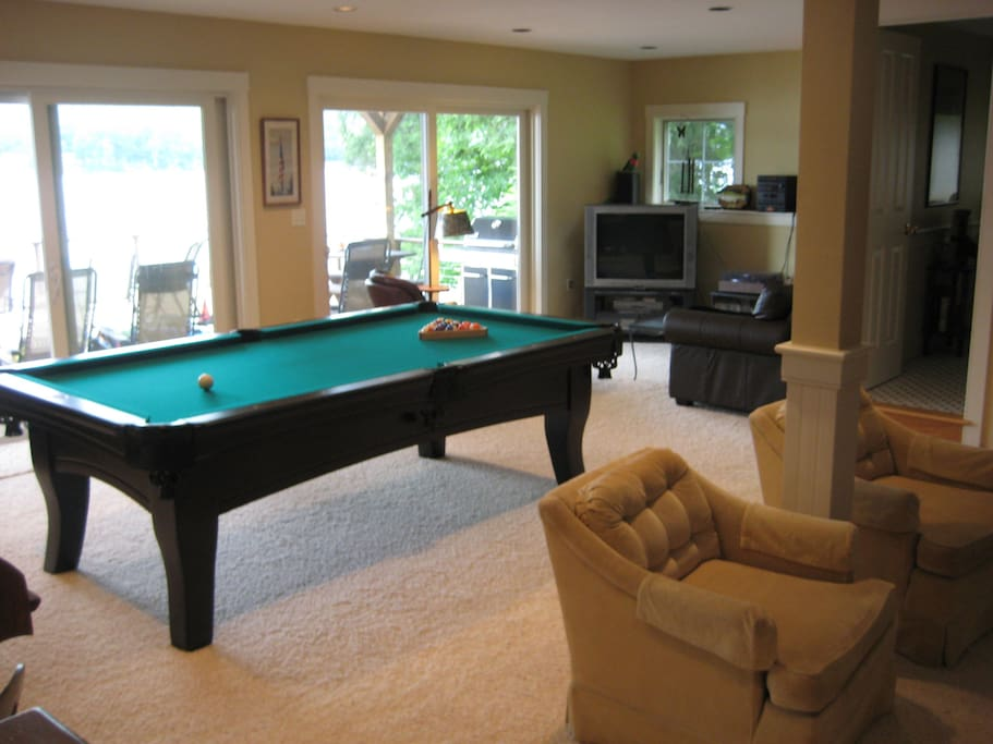 First floor game room (pool table, dart board and TV) opens out to sun deck.