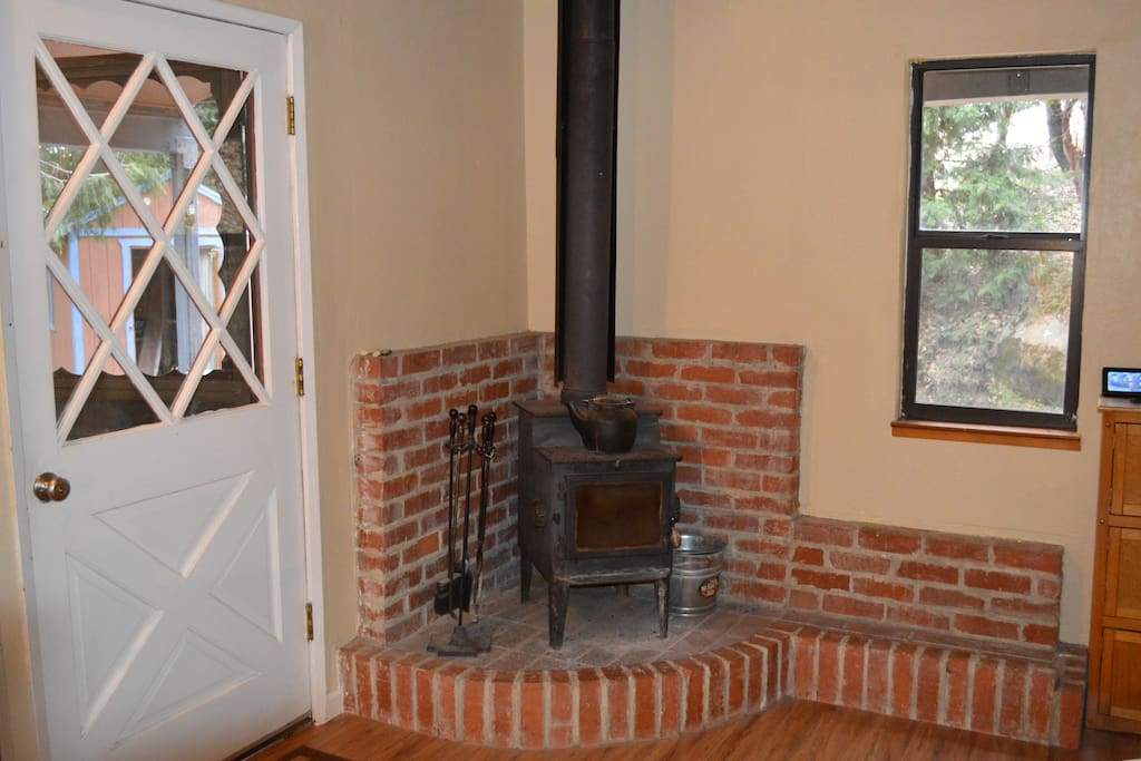 Cozy up by the wood burning stove.I provide the firewood for the guests to use.