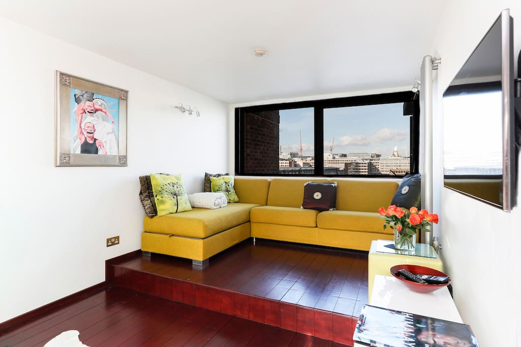 Bright and modern, the open-plan living space has tremendous views. The sofa doubles as a King-sized bed.