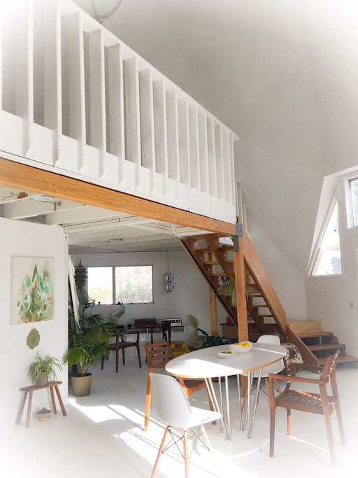 Soaring 20 ft ceilings, interior dining area and music alcove