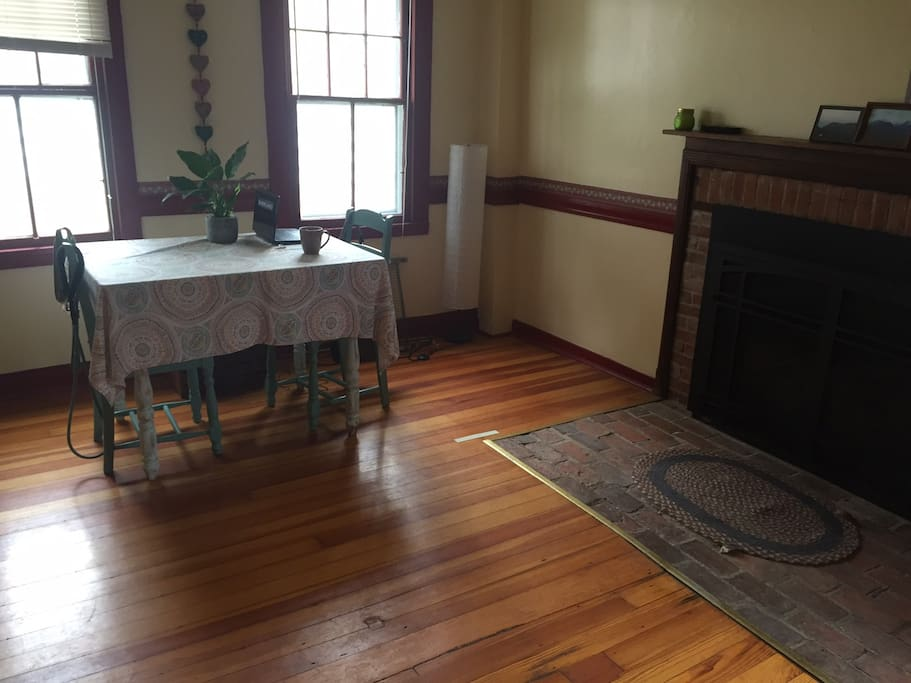 Sunny kitchen and eating area with gas fireplace