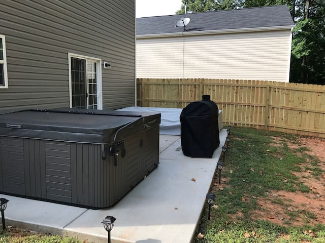 Brand new hot tub, patio furniture, and combo charcoal/gas grill.