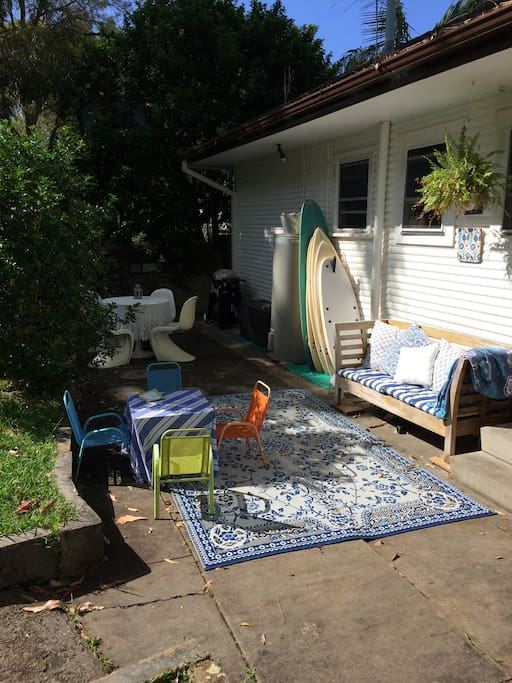Backyard BBQ's including webber bbq, surfboards to use and a relaxing day bed that enjoys the morning sun.