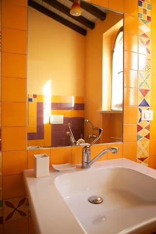 bathroom complete with toilet, bidet, shower, basin