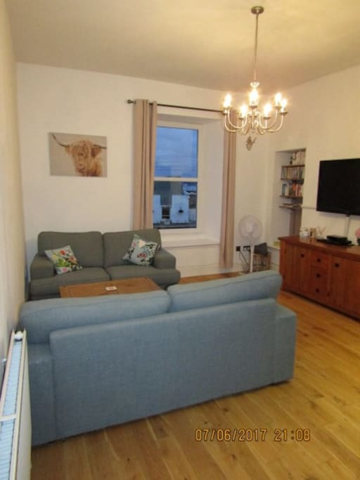 Living room with views of river Clyde