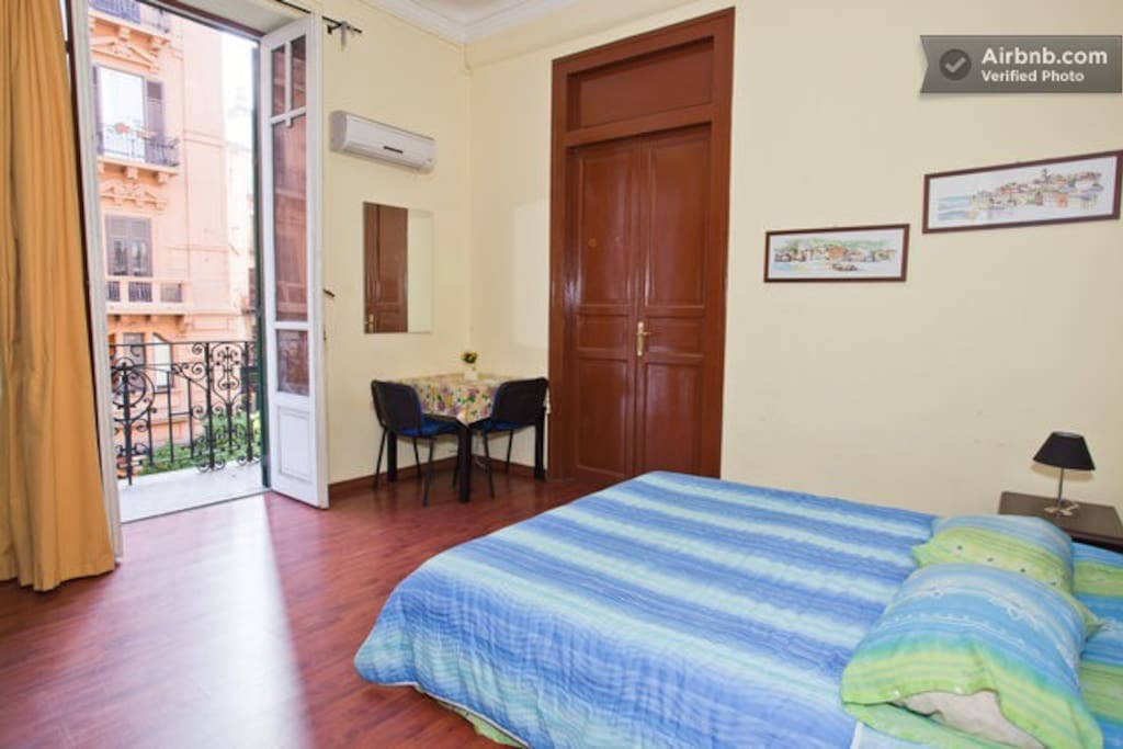 Private room with double bed (we can add an extra bed in occasion of a third guest) and access to the big balcony