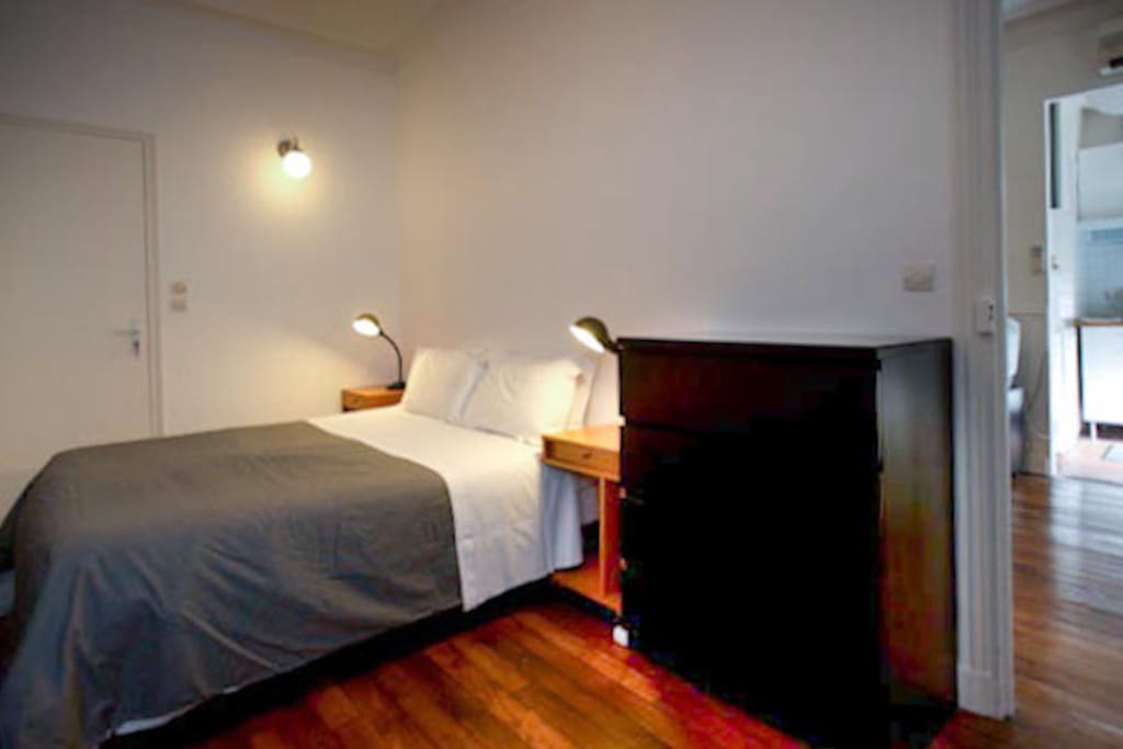 Bedroom, real bed with good reading lights, dresser drawers, door separates the two rooms.