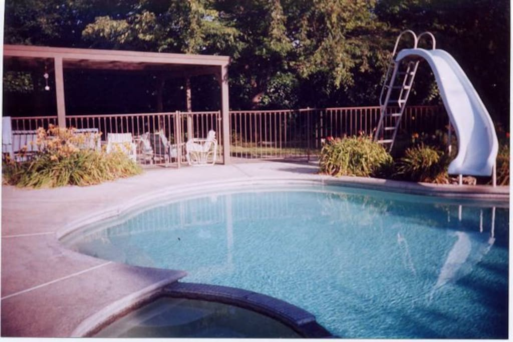 You'll enjoy our free form pool, slide, deck and covered patio