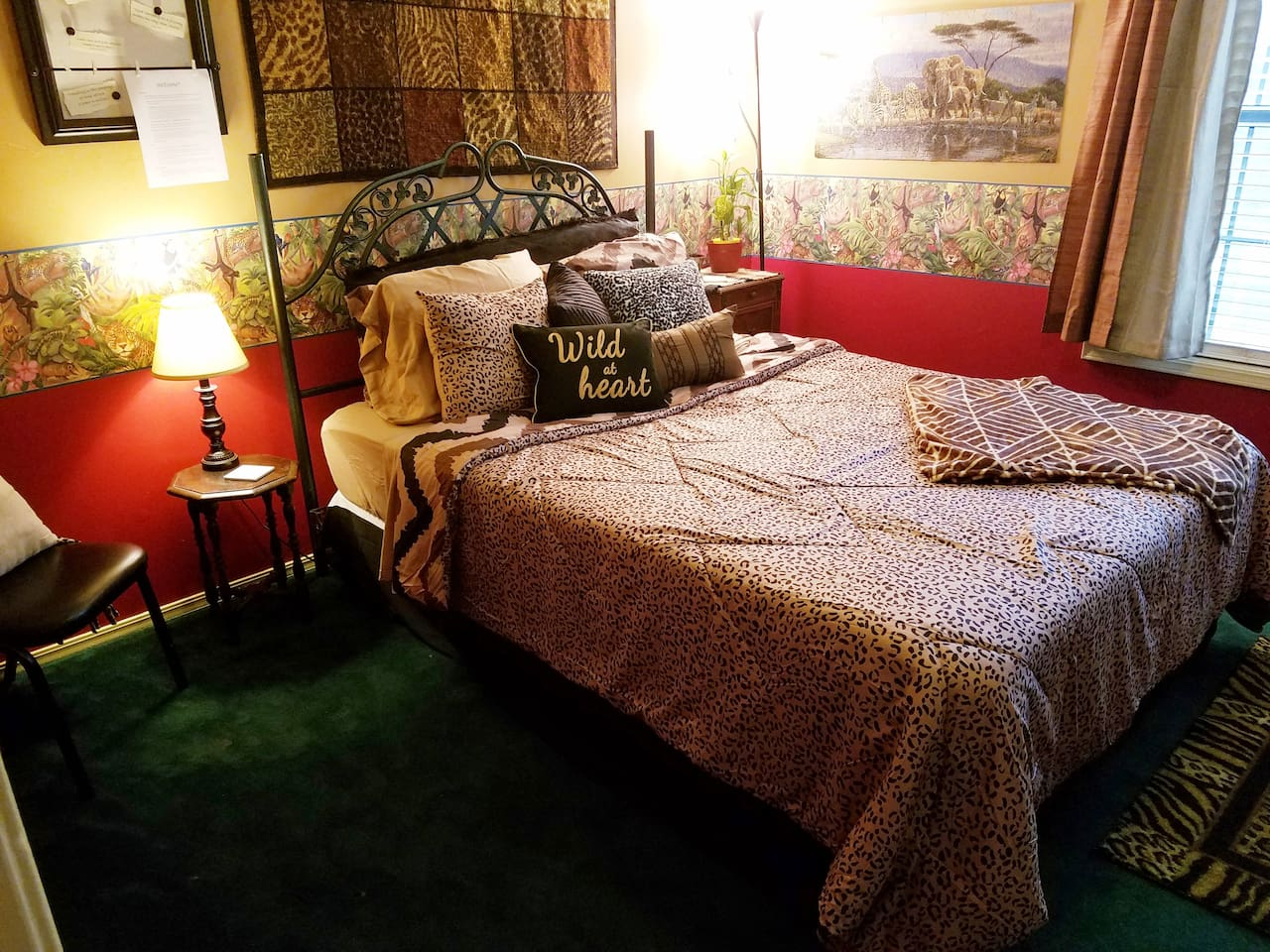 Queen bed, plenty of floor space (add pack n play), night stand & light each side, live plants, 2 walk-in closets, cozy linens, varied pillows, desk & chair, fun decor, large window w/view, black out curtains & blinds, let you sleep in, turn down.