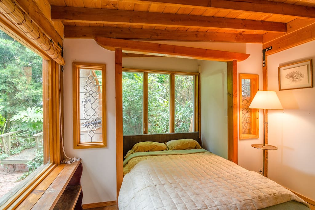 Bedroom by garden with queen size bed