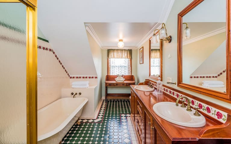Main bathroom is upstairs with double sinks, claw foot bath and  separate shower. Gorgeous Georgian oak washstand with original Victorian jug and basin