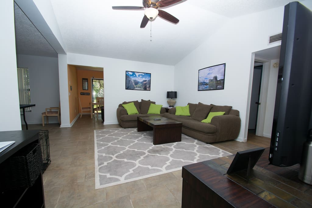 Nice open living room with vaulted ceilings and comfy couches