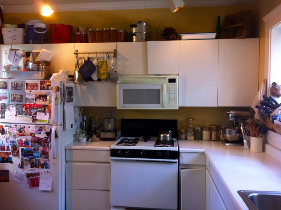 fully equipped chef's kitchen with gas stove, dishwasher, disposal, microwave, coffee equipment