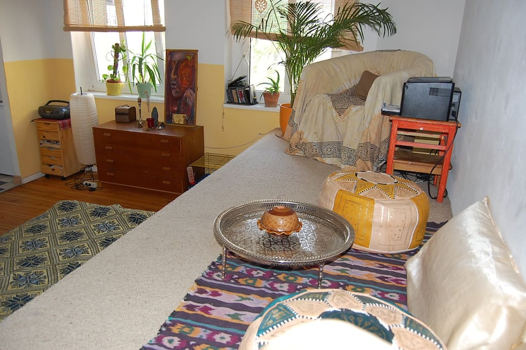 marrocain sitting area with Little tea-table on a wooden Podest with carpet
