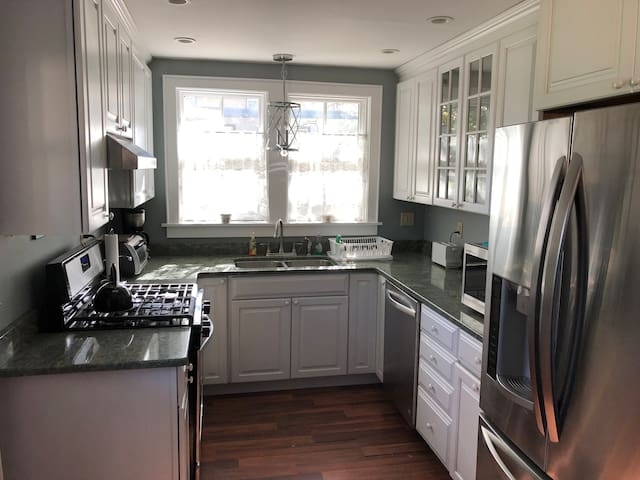 Downstairs: Full kitchen with fridge, oven, microwave, coffee machine, toaster, plates/utensils