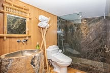 Bathroom features wall-to-ceiling marbled granite walk-in shower
