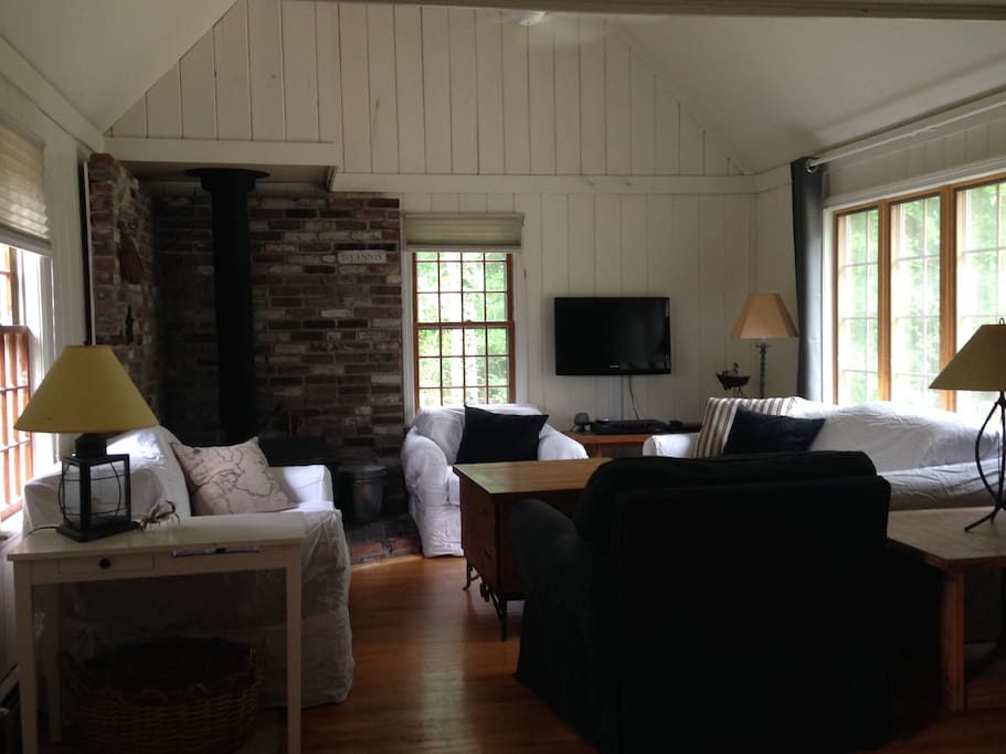 Enter into family room with loft, wood-burning stove