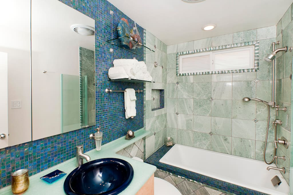 Good Vibe(ette) Tropical California Inspired Bathroom with Marble, Bisazza Tile & Hansgrohe Fixtures